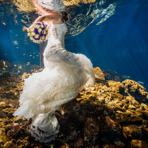 Wedding dress underwater in Mayan cenote Trash the dress