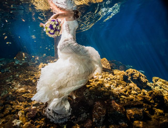 Wedding dress underwater in Mayan cenote Trash the dress
