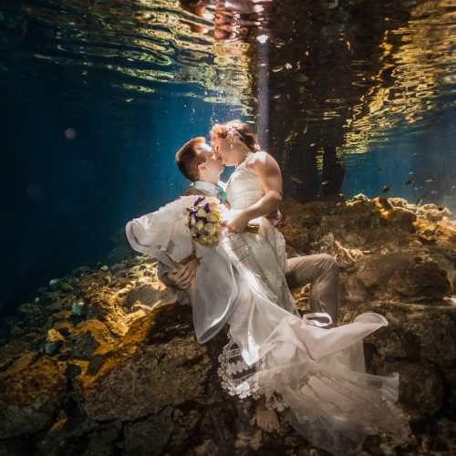 Bride and Groom kissing underwater in Trash the Dress, Riviera Maya