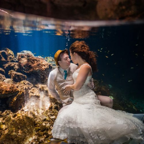 Bride and Groom underwater in Trash the Dress, Riviera Maya, Mexico