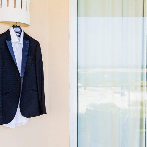 Grooms suit hanging before gay wedding.