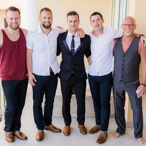 Portrait of groom with friends before wedding at NOW Jade Riviera Cancun
