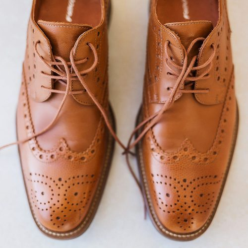 Close up of grooms shoes
