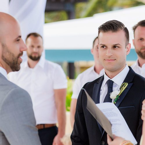 Grooms saying vows at gay wedding at pergola wedding ceremony location