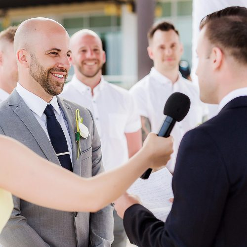 Grooms saying vows at gay wedding