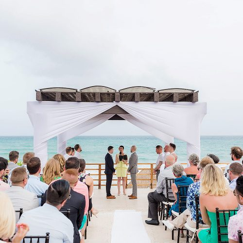 Gay wedding under pergola at NOW Jade Riviera Cancun