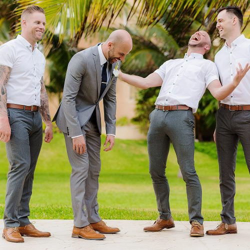Fun photograph of groom with groomsmen