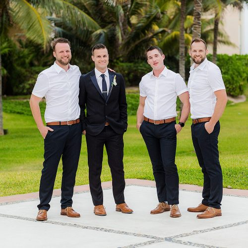 Portrait of groom with groomsmen in garden at NOW Jade Riviera Cancun resort