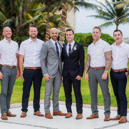 Grooms and bridal party at gay wedding