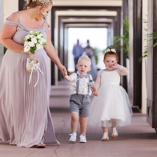 Ring bearer and flower girl walking down aisle at Royalton Riviera Cancun Wedding