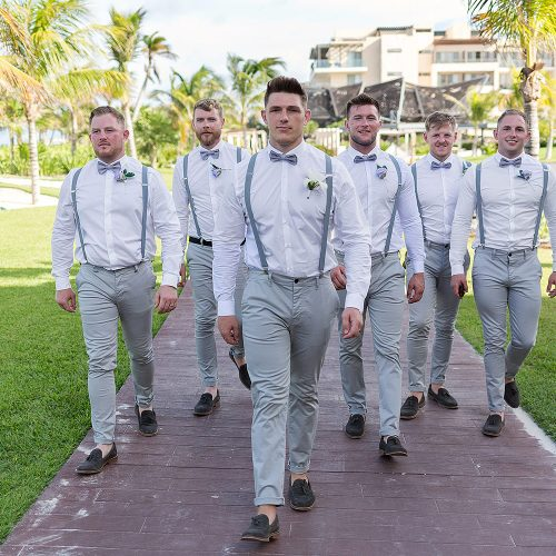 Groomsmen walking after wedding at Royalton Riviera Cancun