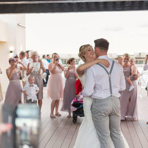 Bride and grooms first dance on skydeck at Royalton Riviera Cancun wedding