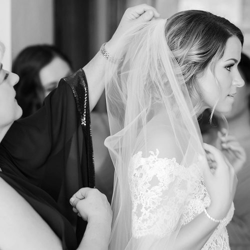 Bride having her veil put on at NOW Jade Cancun wedding