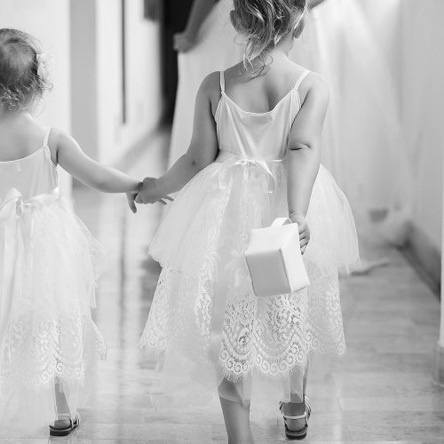 Flower girls walking before wedding at NOW Jade Cancun