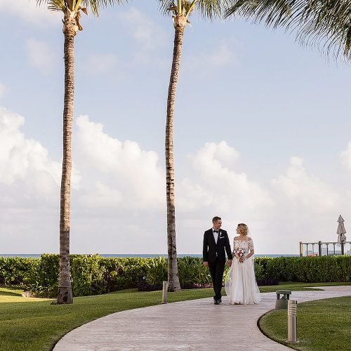 Bride and groom walking on path after their wedding at NOW Jade Cancun