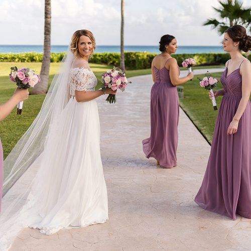Bride and bridesmaids walking after wedding ceremony