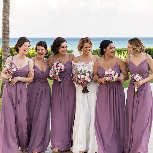 Bridesmaids walking together after wedding.