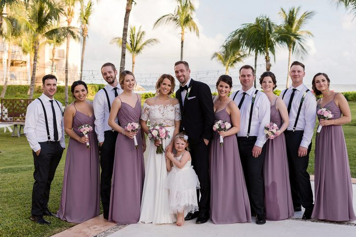 Bridal party portrait in garden at NOW Jade Cancun resort