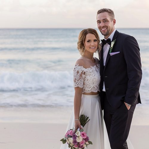 Portrait of bride and groom on the beach at wedding in Cancun
