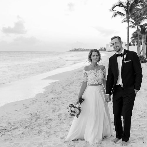 Portrait of bride and groom on beach at wedding in Cancun