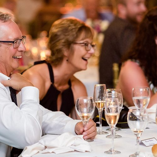 Mother of the bride laughing at wedding reception