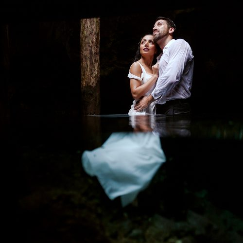 Bride and groom in Cenote Trash the Dress in Mexico