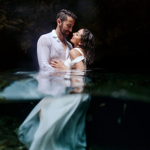 Bride and groom in water at TTD in Mexico