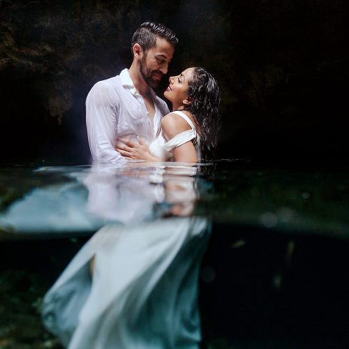 Bride and groom in Cenote at Trash the Dress in Mexico