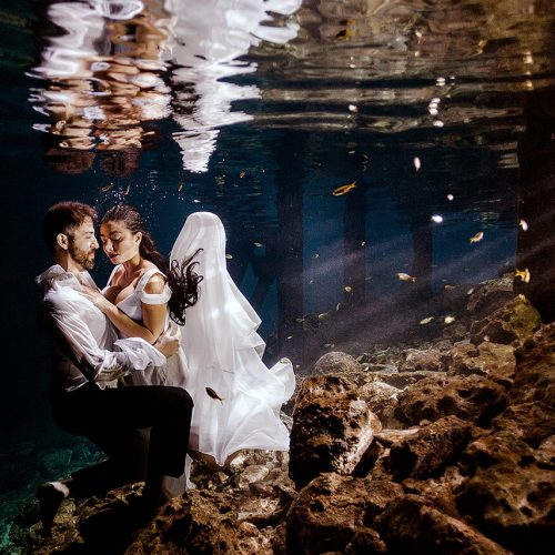 Bride and groom underwater at Mayan Cenote Trash the Dress in Mexico