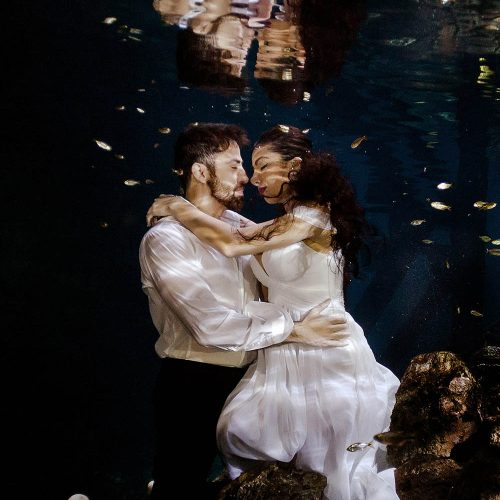 Bride and groom underwater kissing in Mayan Cenote Trash the Dress, Mexico