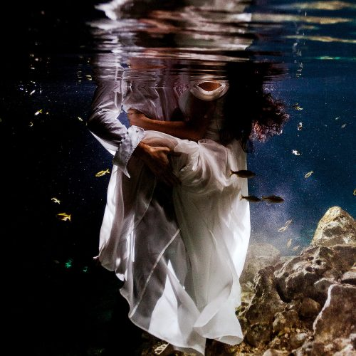 Close up of bride and groom underwater in Mayan Cenote Trash the Dress