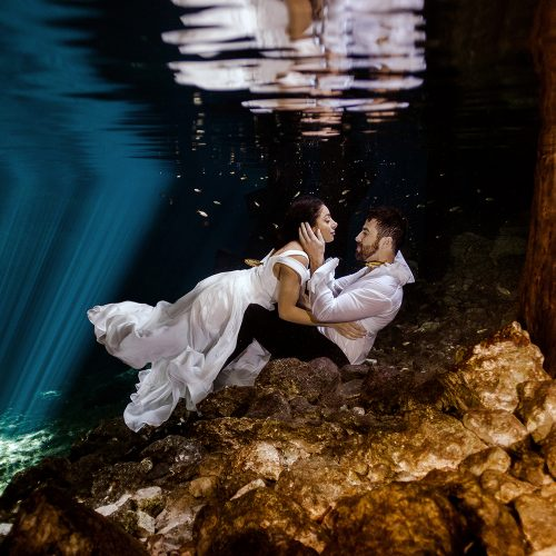 Cenote TTD in Mexico with bride and groom.