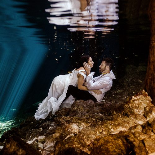 Bride and Groom underwater in Mayan Cenote Trash the dress in Mexico