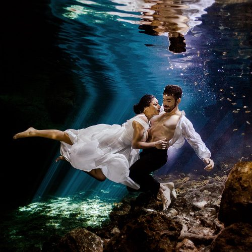 Beautiful photograph of bride and Groom underwater in Mexico