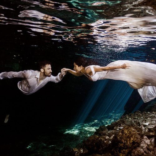 Underwater trash the dress in Riviera Maya Mexico