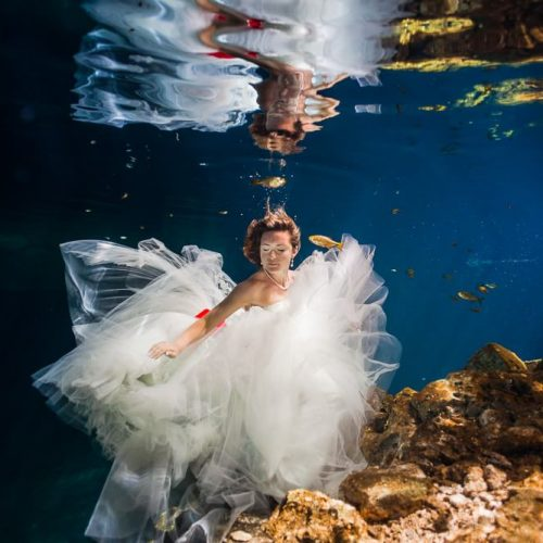 Bride underwater in Trash the Dress shoot in Mexco