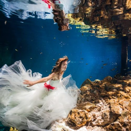 Bride underwater in Trash the Dress shoot in Mexico