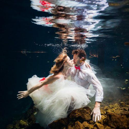 Bride and Groom underwater in Cenote, riviera maya mexico