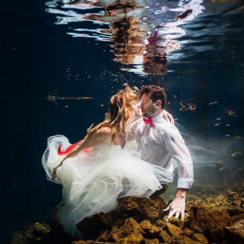 Bride and Groom underwater in wedding closes in Cenote, Riviera Maya Mexico