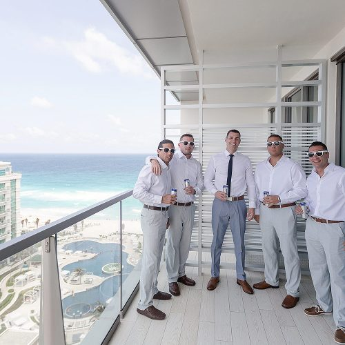 Groomsmen on balcony at Secrets on the vine Cancun