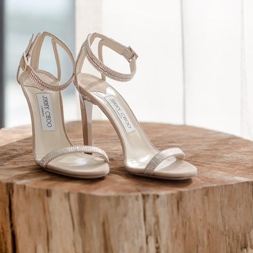 Jimmy Choo's on wood block