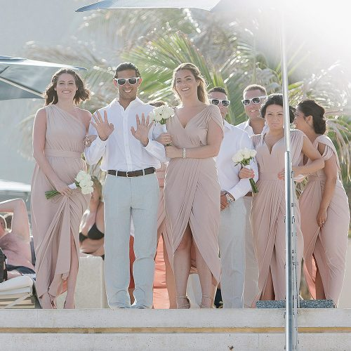 Wedding party arriving at ceremony on beach.