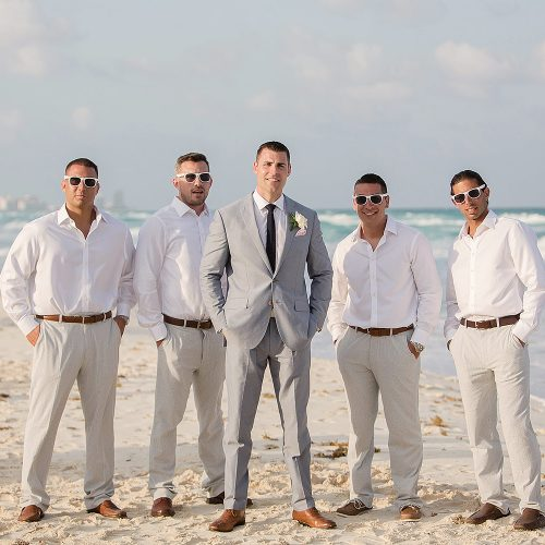 Groom and groomsmen on beach in Cancun
