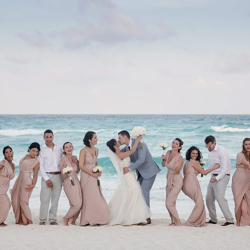 Bridal party on beach in Cancun