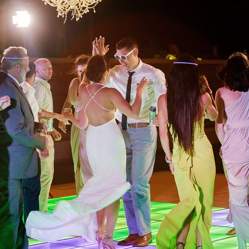 Bride and groom dancing with guests at wedding reception at Secrets on the vine Cancun