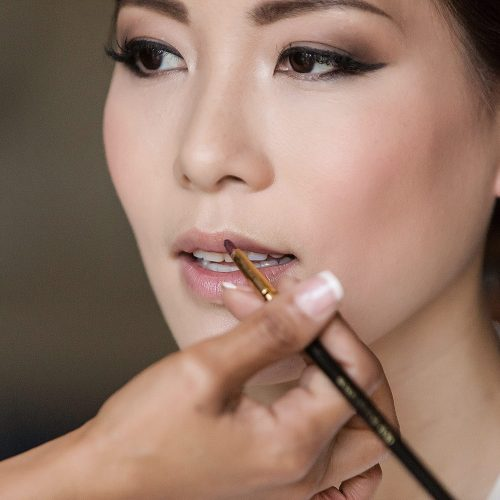 Close up of bride having makeup done by Styling Trio