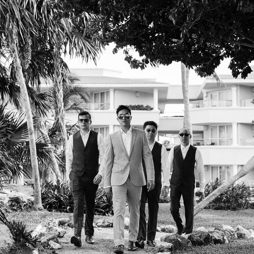 Groomsmen walking at Moon Palace Cancun