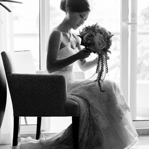 Portrait of bride on chair in room at Moon Palace Cancun wedding