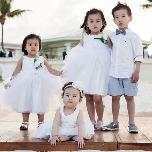 Flower girls and ring bearers at wedding in Cancun