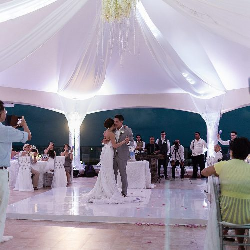 Bride and grooms first dance under gazebo at Moon Palace Cancun